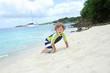 Child having Fun on Tropical Beach near Ocean