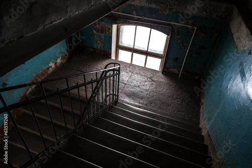 Dark abandoned stairway interior in old living house