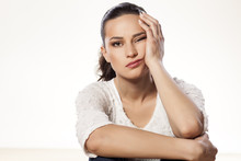 Young Woman Full Of Boredom Leaned Her Head On Her Hand