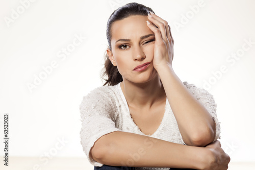 Fotografie, Obraz  young woman full of boredom leaned her head on her hand