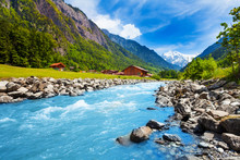 Swiss Landscape With River Stream And Houses