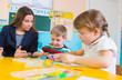 Little children at applique lesson