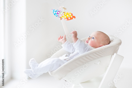 Cute Newborn Baby Boy Watching A Colorful Mobile Toy Buy This