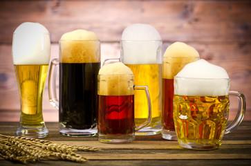 Fototapeta Variety of beer glasses on a wooden table