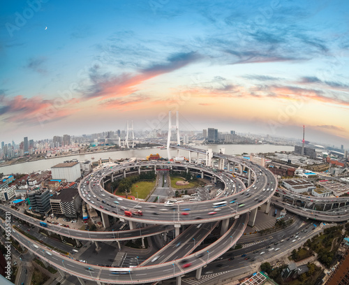 Valokuva  aerial view of shanghai nanpu bridge in sunset
