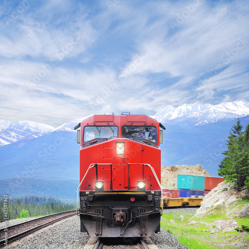 Photo  Freight train in Canadian rockies.