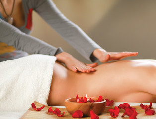 Obraz na płótnie Canvas Beautiful young woman getting spa massage