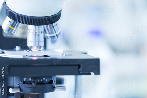 Fotografia  Close up of microscope at the blood laboratory, Concept Science and Technology