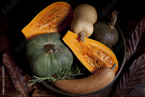 Fotografie, Obraz  variety of pumpkins with rustic autumnal background