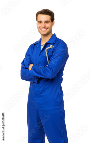 Handsome Mechanic In Overalls Holding Wrench