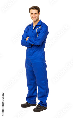 Fotografía  Mechanic In Overalls Holding Wrench