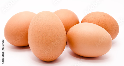 Brown chicken eggs isolated on a white background closeup