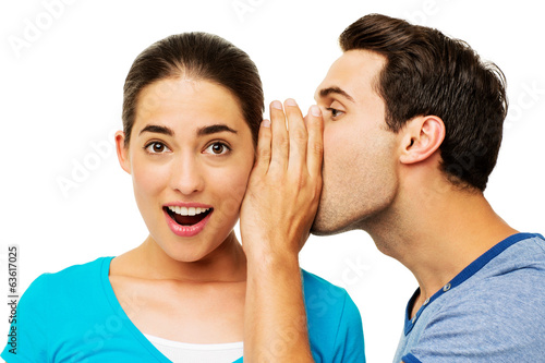 Man Sharing Secret With Surprised Woman Canvas Print
