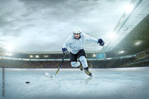 Papiers peints Glisse hiver Ice hockey player on the ice. Open stadium - Winter Classic game