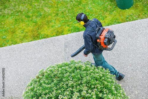 gardener using a gas blower in a park Canvas Print