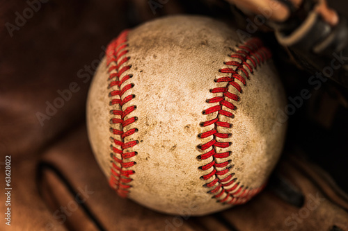 Baseball glove with ball Poster