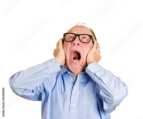Loud noises  Annoyed old man covers his ears, tired of neighbor