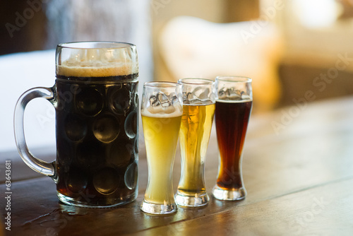 Canvas Prints Beer / Cider Glass of different types beer on a pub