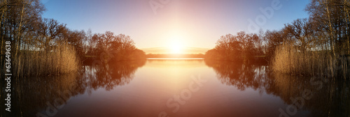 Photo sur Toile Brun profond Stunning Spring sunrise landscape over lake with reflections and