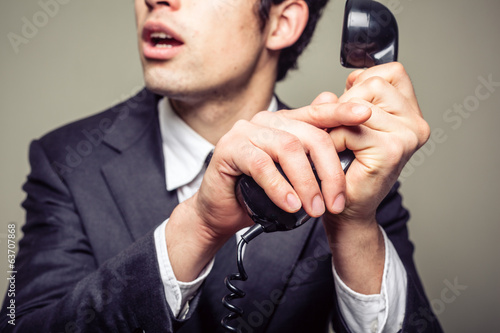 Canvas Print Businessman covering the phone