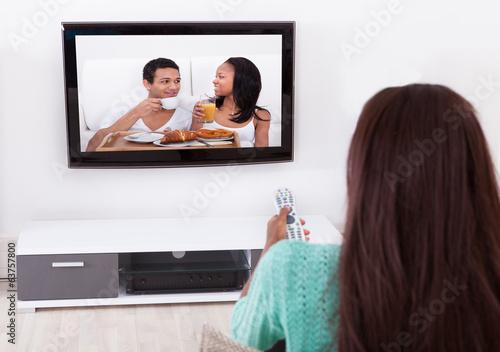 Fototapeta Woman Watching TV In Living Room obraz na płótnie