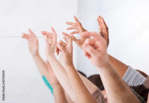 Fototapety, obrazy: Row Of College Students Raising Hands