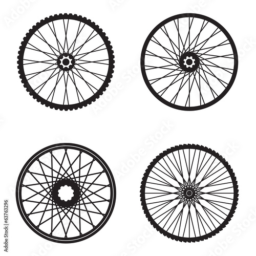 Bicycle wheels isolated on white background, vector format Wall mural