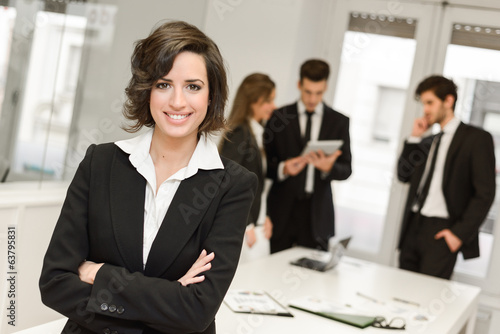 Fotografía  Business leader looking at camera in working environment