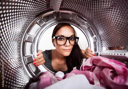 Fotografia, Obraz  Young woman doing laundry