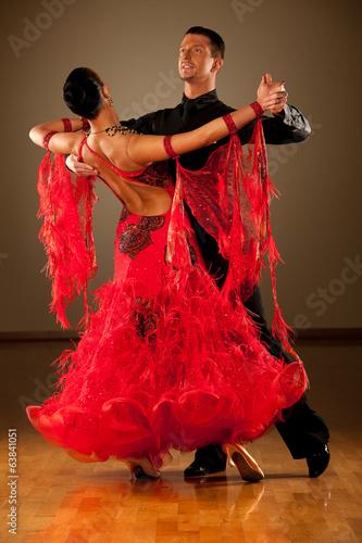 Professional ballroom dance couple preform an exhibition dance Fototapeta