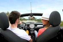 Young Couple Driving Convertib...