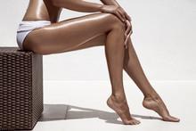 Beautiful Woman Tan Legs. Agai...