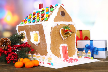Beautiful gingerbread house with Christmas decor on wooden