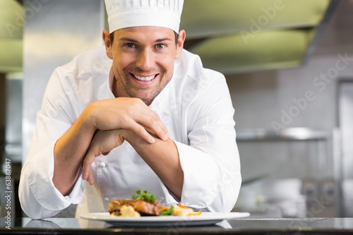Fotografie, Obraz  Smiling male chef with cooked food in kitchen