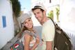 Smiling couple of backpackers enjoying journey