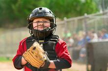 Portrait Of Child Baseball Player Wearing Catcher Gear