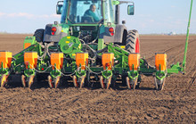 Agricultural Tractor Sowing An...