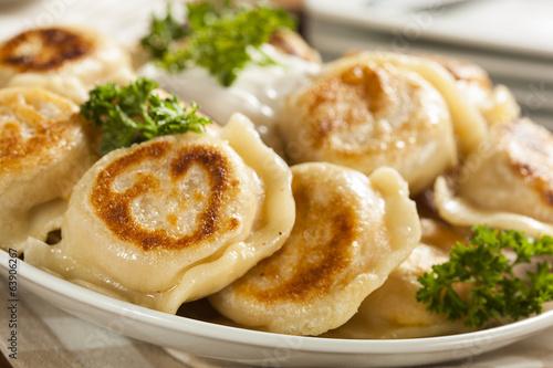 Fotografie, Obraz  Homemade Polish Pierogis with Sour Cream