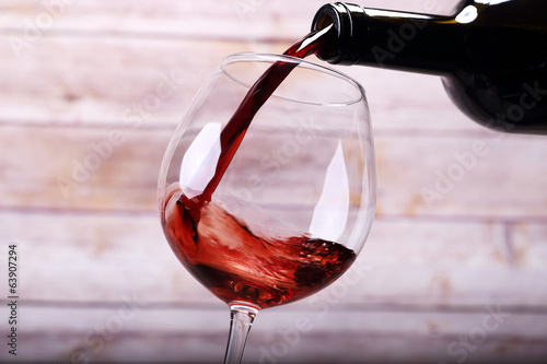 Pouring wine into glass and background