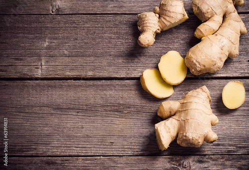 Fotografie, Obraz  Ginger root sliced on wooden background