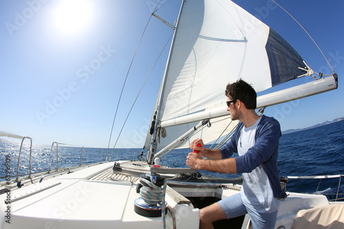 Tuinposter Zeilen Man sailing with sails out on a sunny day