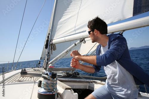 Voile Man sailing with sails out on a sunny day