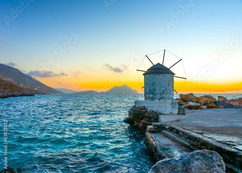 old windmill by the port of Aigiali in Amorgos island in Greece Canvas Print