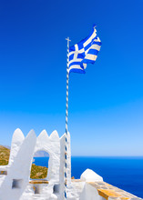 Greek Flag Fluttering In A Monastery In Amorgos Island In Greece