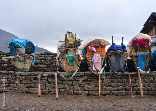 Wall Murals Nepal Heavy loads of porters in the Himalaya Mountains, Nepal
