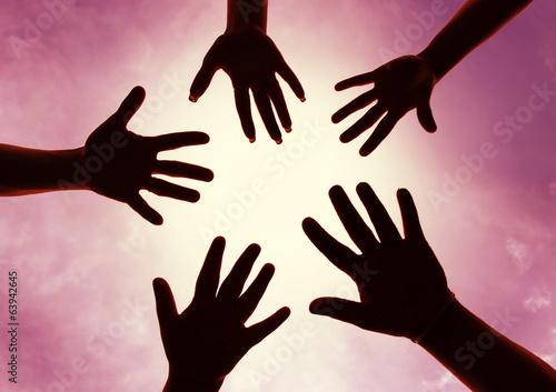 Obraz na plátně  Five hands symbol of union touch white light