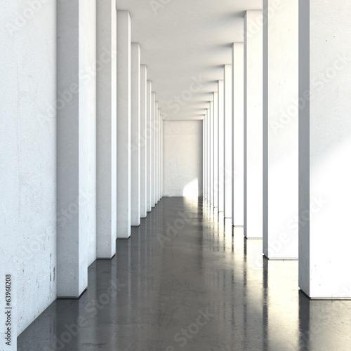pusty-dlugi-korytarz-z-duzymi-kolumnami