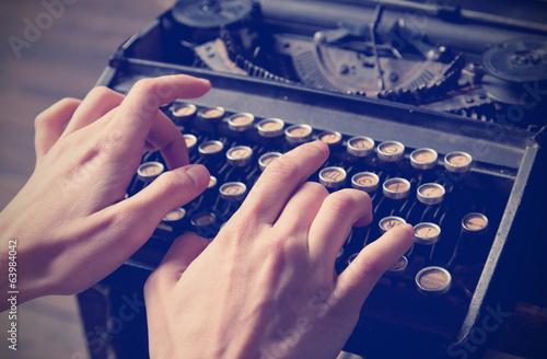 Foto op Plexiglas Retro Human hand prints on retro typewriter, instagram effect