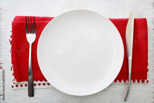 Fotografie, Obraz  White plate with fork and knife