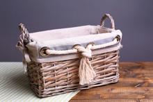 Empty Wicker Basket On Wooden Table, On Dark Background